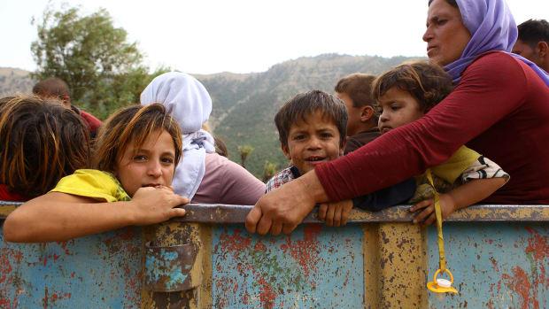 ISIS women children Syria Iraq Islamic extremism Yazidi rape slavery Sunni jihad