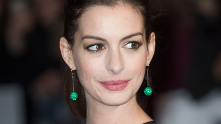 Anne Hathaway Outsmarted the Paparazzi, But Is Consent Really All That Matters?