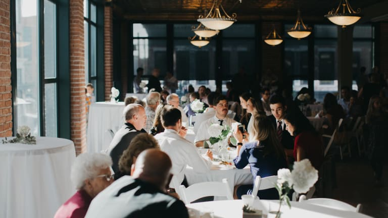 Here's How I Survived a First Date at a Wedding