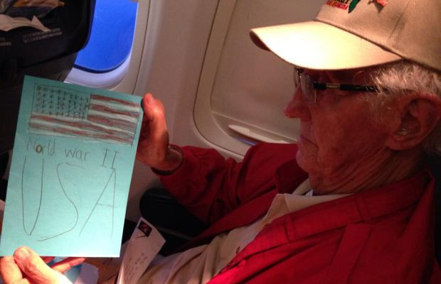 Bob reads a handmade card reminding him of his service during World War II.