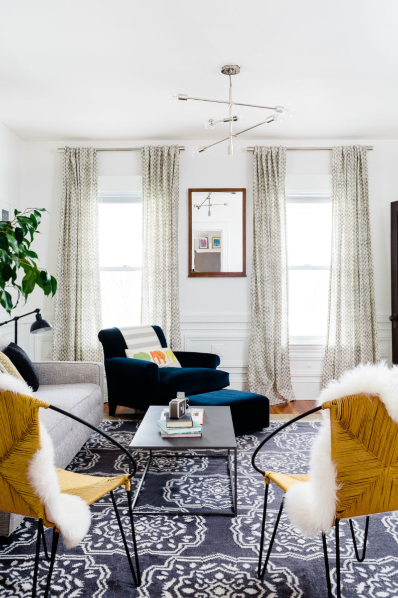 The mid-century modern coffee table in this Boston flat was another Craigslist gem. Photo by Joyelle West for Homepolish, Designed by Shannon Tate