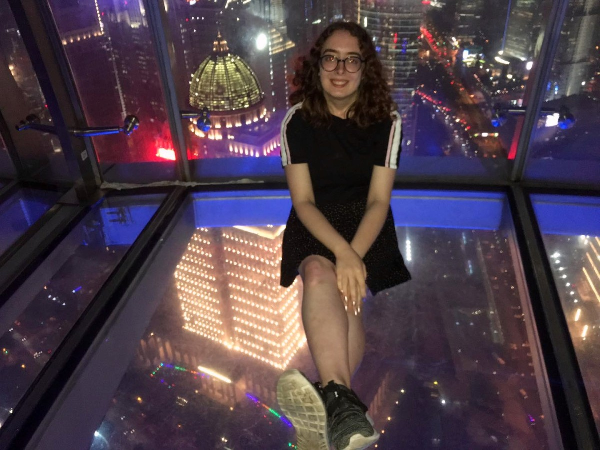 Paige in the glass-bottomed sightseeing corridor of the Oriental Pearl Tower