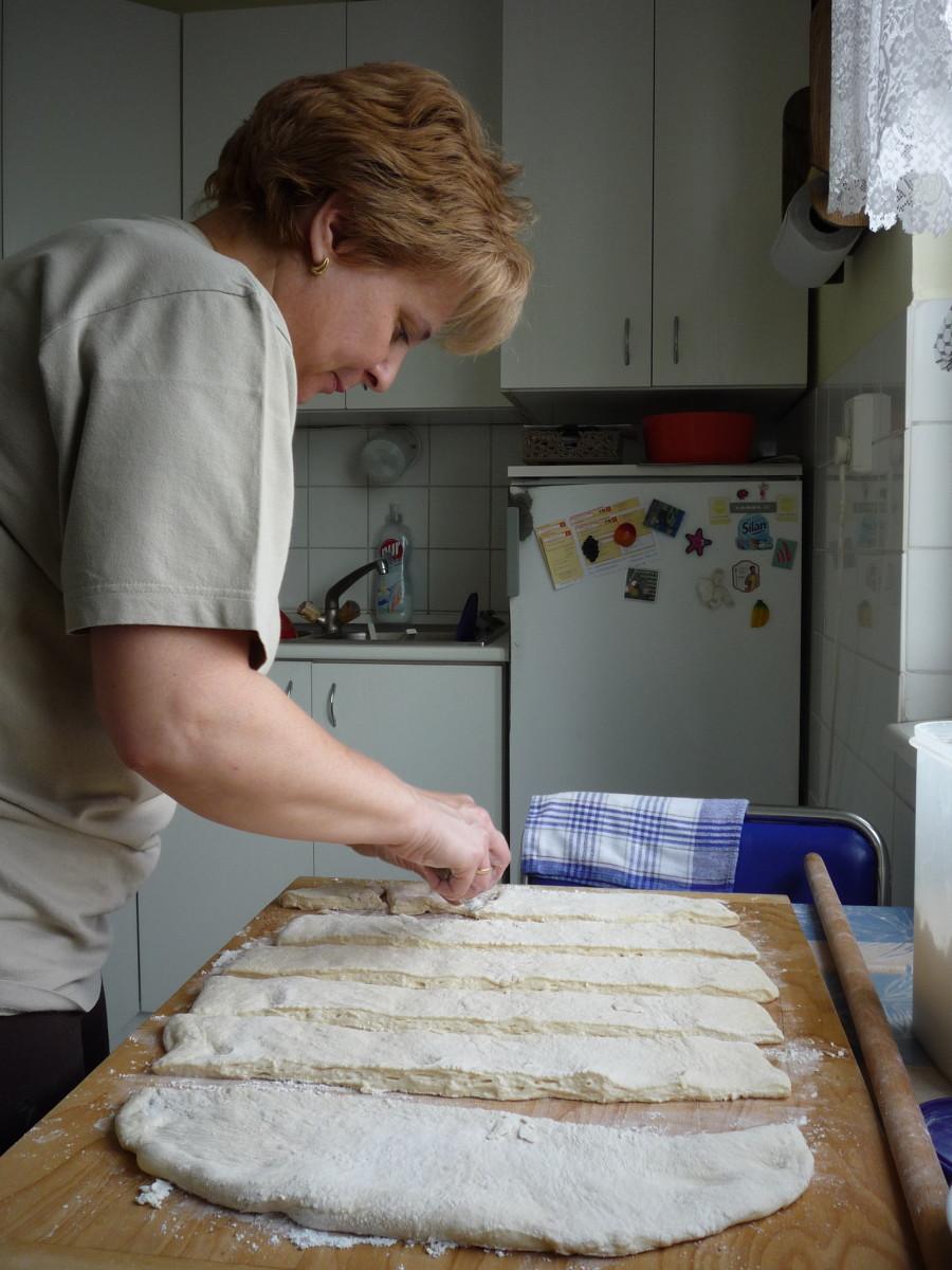 A colleague teaching Sarah to make Lángos